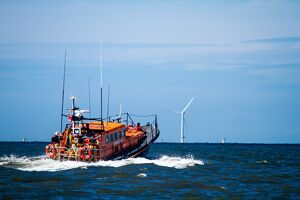 Rhyl Mersey class lifeboat Lil Cunningham 12-24 heading out to sea, windfarms in