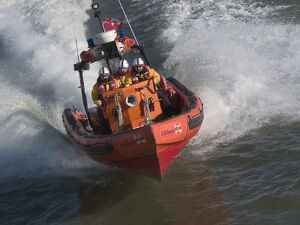 Tower Pier E class lifeboat powering along theThames at high spe